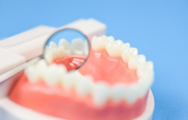 dental-care-concept-dentist-tools-with-dentures-dentistry-instruments-dental-hygiene-equipment-checkup-with-teeth-model-mouth-mirror-oral-health_73523-3175